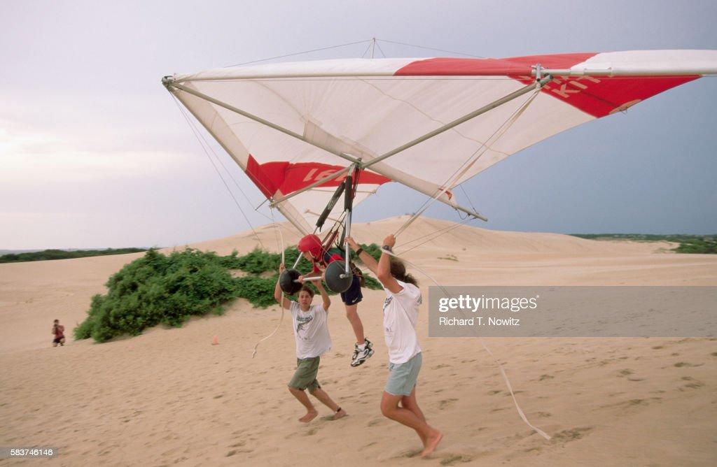 Hang Gliding Instructors Help Student