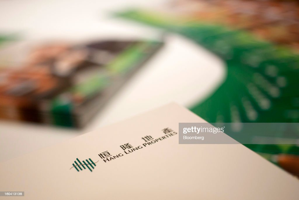 Hang Lung Properties Ltd. brochures are displayed on a table during a news conference in Hong Kong, China, on Thursday, Jan. 31, 2013. Hang Lung, the Hong Kong developer investing more than $8.5 billion building malls in mainland China, said 2012 underlying profit almost doubled after the company sold more properties in the city. Photographer: Jerome Favre/Bloomberg via Getty Images