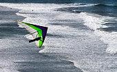 CARPINTERIA CA APR 8 2011 A hang–glider sailing over the beach in Carpinteria near the Ventura/Santa Barbara County line on Apr 8 2011