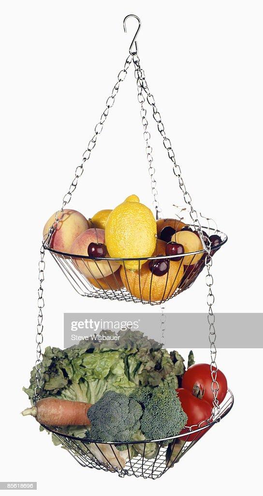 Hanging Basket Full Of Fresh Fruit And Vegetables Stock