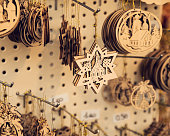 Hanging Christmas tree hand carved wooden decorations in market stall