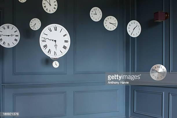 Hanging clocks in sitting room