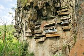Philippinos in the mountain region of Sagada used to hang coffins with their dead down a cliff as a burial tradition in Echo Valley, Sagada, Northern Luzon, Philippines