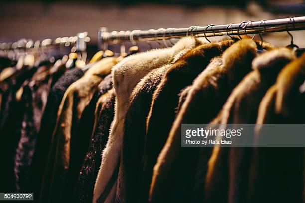Hanging fur coats on clothes rack