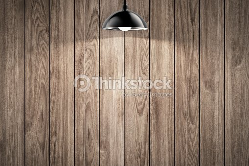 Hanging light bulb with timber wall background stock photo thinkstock hanging light bulb with timber wall background stock photo aloadofball Images