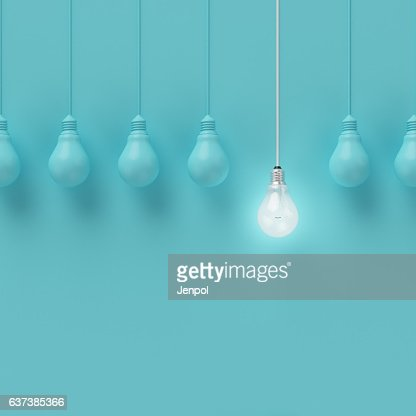 Hanging light bulbs with glowing one different idea. : Foto de stock