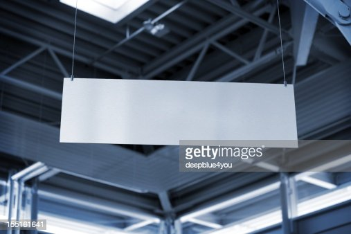 hanging metal billboard in business room