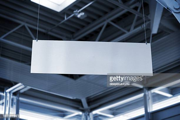 hanging metal billboard in business room