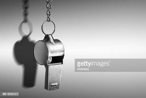 Hanging metal whistle closeup photo : Stock Photo