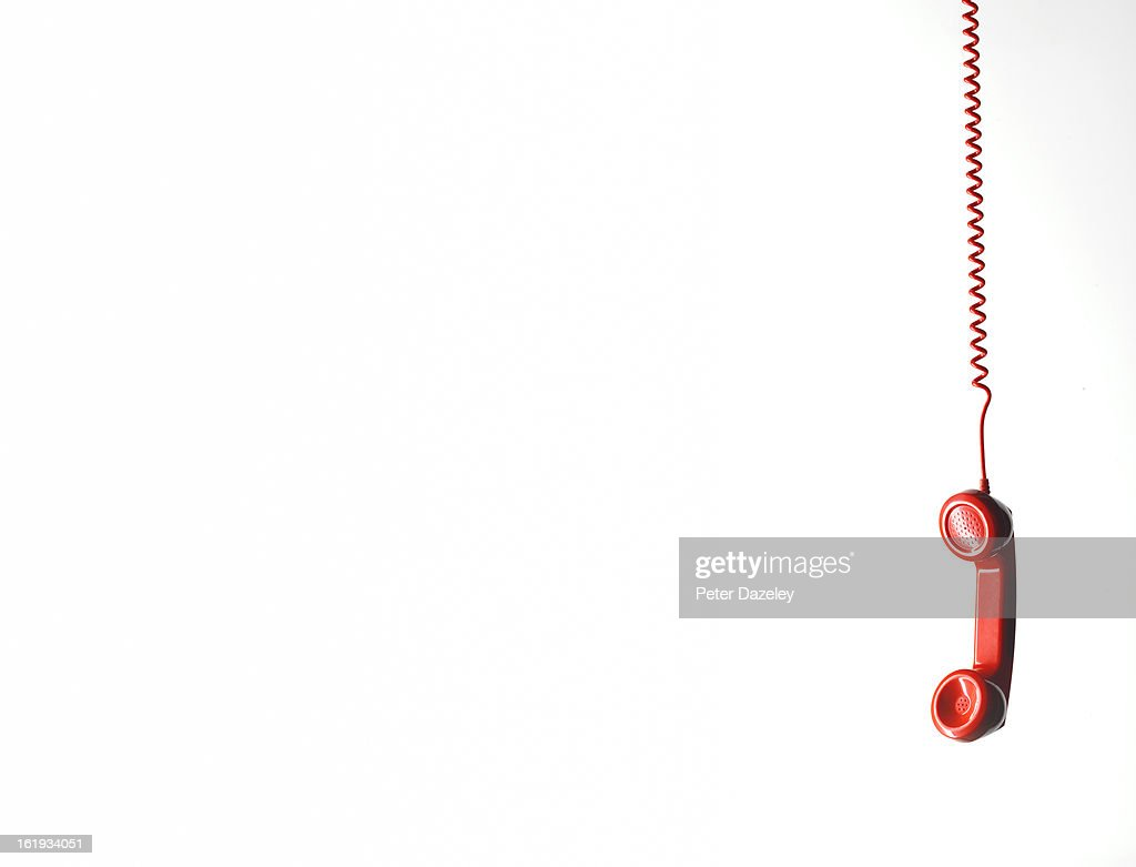 Hanging red phone with copy space