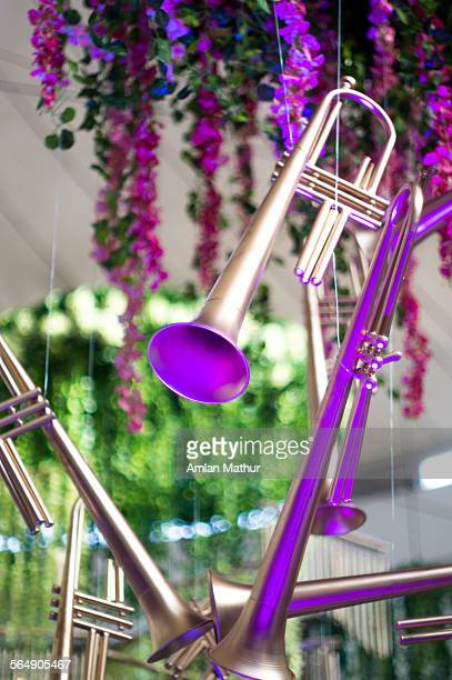 Hanging trumpets against flowers