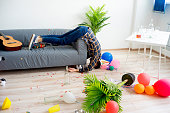 A guy is sleeping after a party with a hangover