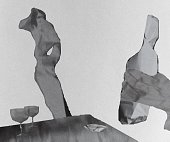 Photo of crumpled paper by Irina Babina. Here is a room. There are two people in it. One man is holding a bottle in his hands. Only his hand is visible in the frame. In the center of the room is a wom