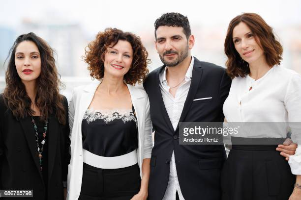 Hania Amar Nadia Kaci Mehdi Ramdani and Aure Atika attend 'Waiting For Swallows ' photocall during the 70th annual Cannes Film Festival at Palais des...
