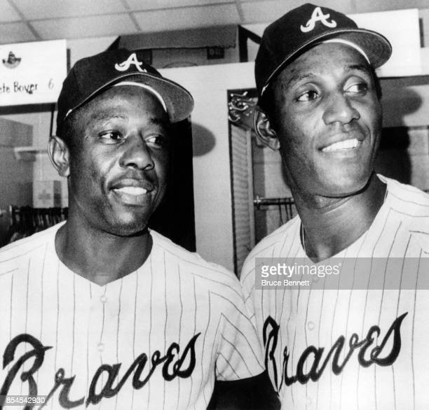 Hank Aaron and Rico Carty of the Atlanta Braves pose for a portrait in the locker room as they both were voted to play in the 1970 AllStar Game on...