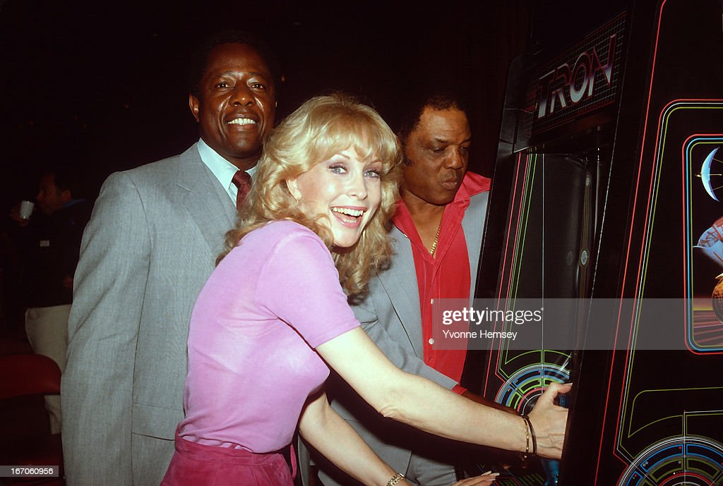 Hank Aaron, Barbara Eden, and Willy Mays promote a Tron arcade game contest July 7, 1982 in New York City.