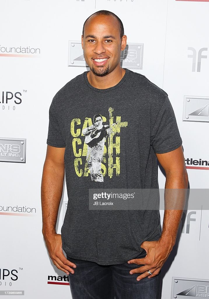 <a gi-track='captionPersonalityLinkClicked' href=/galleries/search?phrase=Hank+Baskett&family=editorial&specificpeople=749185 ng-click='$event.stopPropagation()'>Hank Baskett</a> attends the Matt Leinart Foundation's 7th Annual 'Celebrity Bowl' at Lucky Strikes on July 18, 2013 in Hollywood, California.
