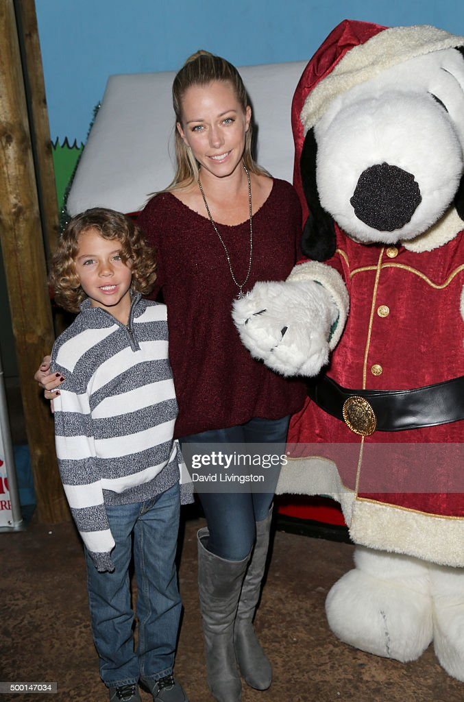 Hank Baskett IV Kendra Wilkinson and Snoopy attend Knott's Berry Farm's Countdown To Christmas And Snoopy's Merriest Tree Lighting at Knott's Berry...