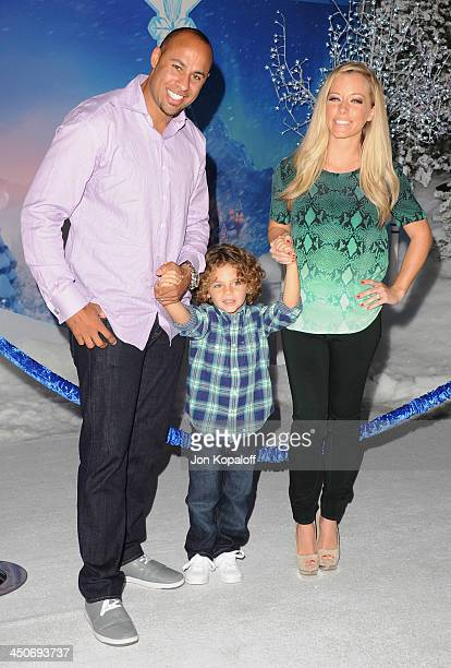 Hank Baskett son Hank Baskett and wife Kendra Wilkinson arrive at the Los Angeles Premiere 'Frozen' at the El Capitan Theatre on November 19 2013 in...