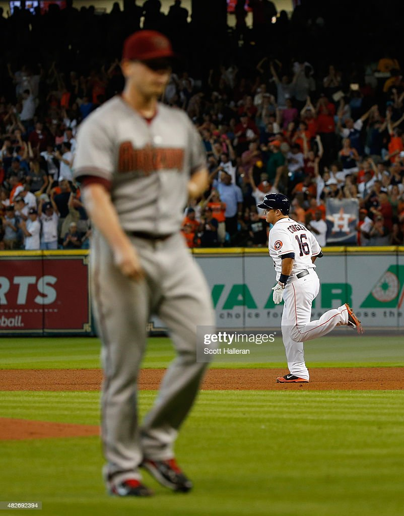 Hank Conger #16 of the Houston Astros rounds the bases after hitting a grand slam in the fourth inning off Jeremy Hellickson #58 of the Arizona Diamondbacks during their game at Minute Maid Park on August 1, 2015 in Houston, Texas.