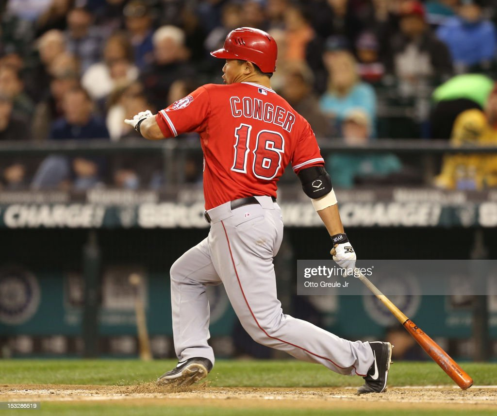 <a gi-track='captionPersonalityLinkClicked' href=/galleries/search?phrase=Hank+Conger&family=editorial&specificpeople=713039 ng-click='$event.stopPropagation()'>Hank Conger</a> #16 of the Los Angeles Angels of Anaheim hits into a fielders choice in the sixth inning against the Seattle Mariners at Safeco Field on October 2, 2012 in Seattle, Washington.
