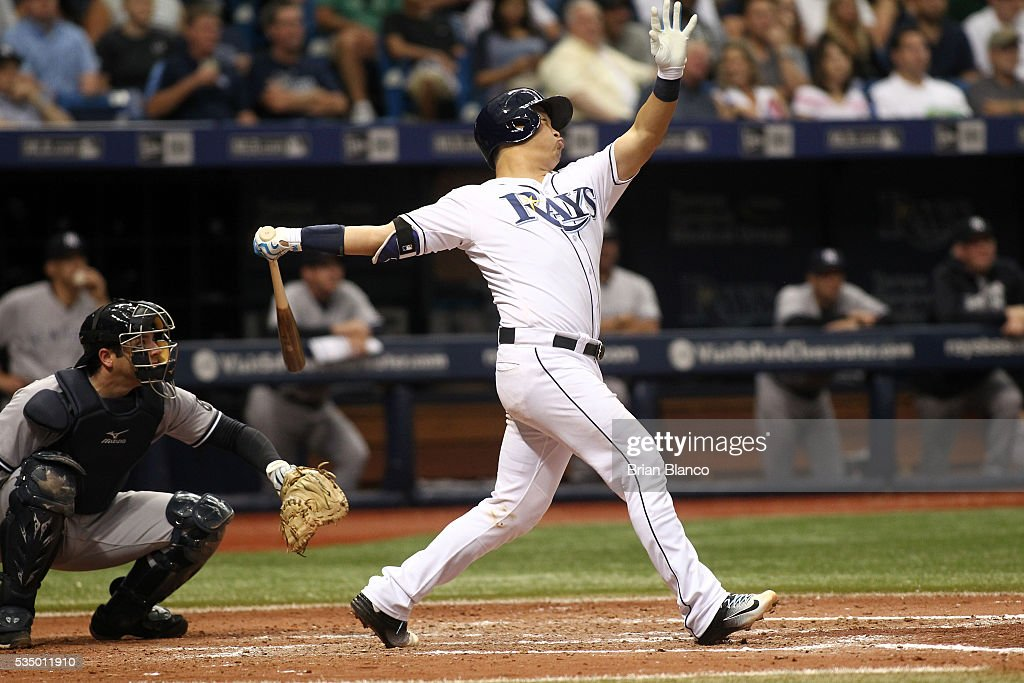 <a gi-track='captionPersonalityLinkClicked' href=/galleries/search?phrase=Hank+Conger&family=editorial&specificpeople=713039 ng-click='$event.stopPropagation()'>Hank Conger</a> #24 of the Tampa Bay Rays hits a three-run home run in front of catcher Austin Romine #27 of the New York Yankees during the fifth inning of a game on May 28, 2016 at Tropicana Field in St. Petersburg, Florida.