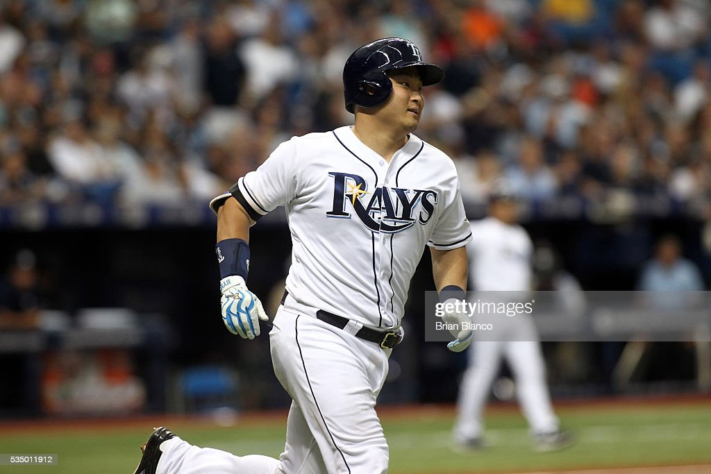 <a gi-track='captionPersonalityLinkClicked' href=/galleries/search?phrase=Hank+Conger&family=editorial&specificpeople=713039 ng-click='$event.stopPropagation()'>Hank Conger</a> #24 of the Tampa Bay Rays rounds first base after hitting a three-run home run during the fifth inning of a game against the New York Yankees on May 28, 2016 at Tropicana Field in St. Petersburg, Florida.