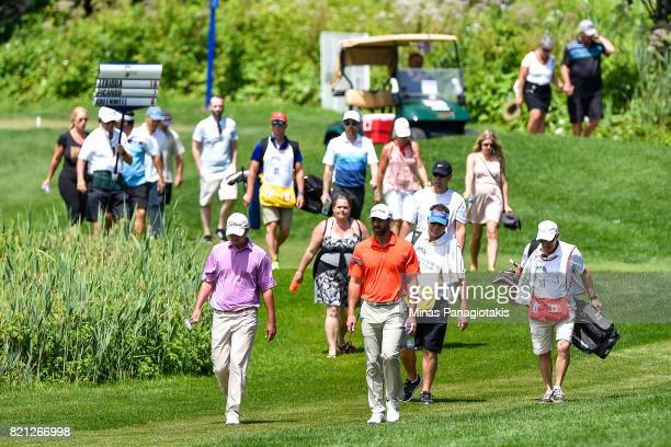 Hank Lebioda and Matthew Picanso walk on the third green as fans follow behind during the final round of the Mackenzie Investments Open at Club de...