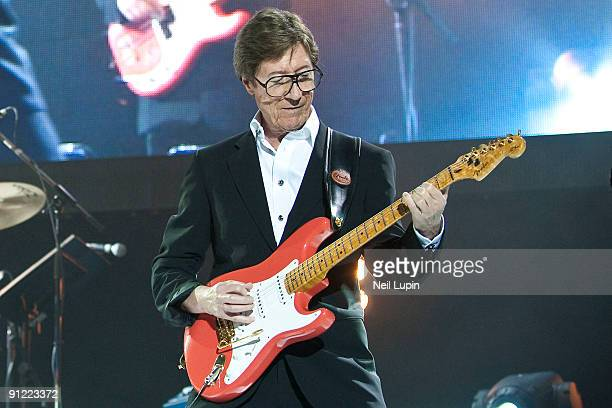 Hank Marvin performs on stage with Cliff Richard and The Shadows at the O2 Arena on September 28 2009 in London England