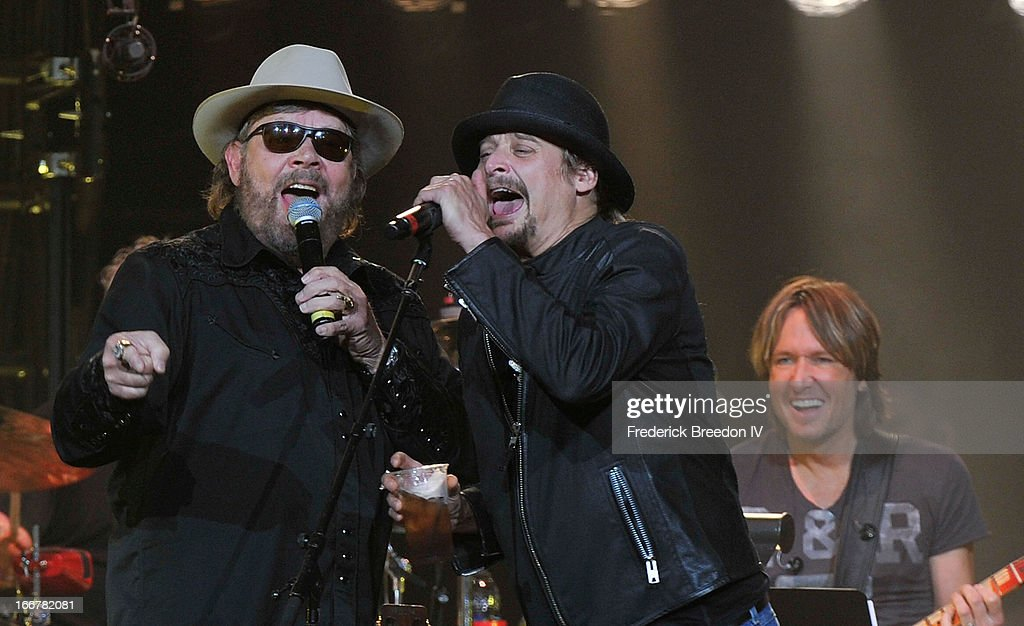 Hank Williams Jr., Kid Rock and Keith Urban perform during Keith Urban's Fourth annual We're All For The Hall benefit concert at Bridgestone Arena on April 16, 2013 in Nashville, Tennessee.