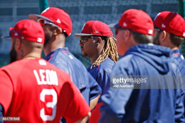 Hanley Ramirez among other players listen to third base coach Brian Butterfield of the Boston Red Sox during a meeting at home plate prior to the...