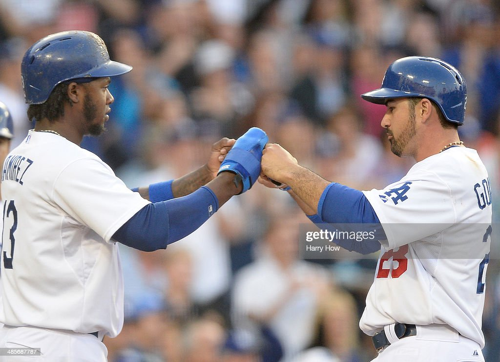 <a gi-track='captionPersonalityLinkClicked' href=/galleries/search?phrase=Hanley+Ramirez&family=editorial&specificpeople=538406 ng-click='$event.stopPropagation()'>Hanley Ramirez</a> #13 and Adrian Gonzalez #23 of the Los Angeles Dodgers celebrate their runs from a Matt Kemp #27 double to take a 8-4 lead over the Arizona Diamondbacks during the fifth inning at Dodger Stadium on April 19, 2014 in Los Angeles, California.