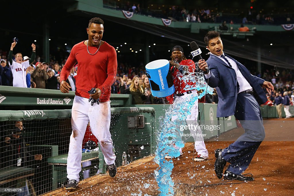 Hanley Ramirez #13 dumps Powerade on Xander Bogaerts #2 of the Boston Red Sox and NESN reporter Gary Striewski after the game against the Baltimore Orioles at Fenway Park on April 17, 2015 in Boston, Massachusetts. Bogaerts singled to right field allowing Mike Napoli #12 to score the game winning ru. The Red Sox defeat the Orioles 3-2.