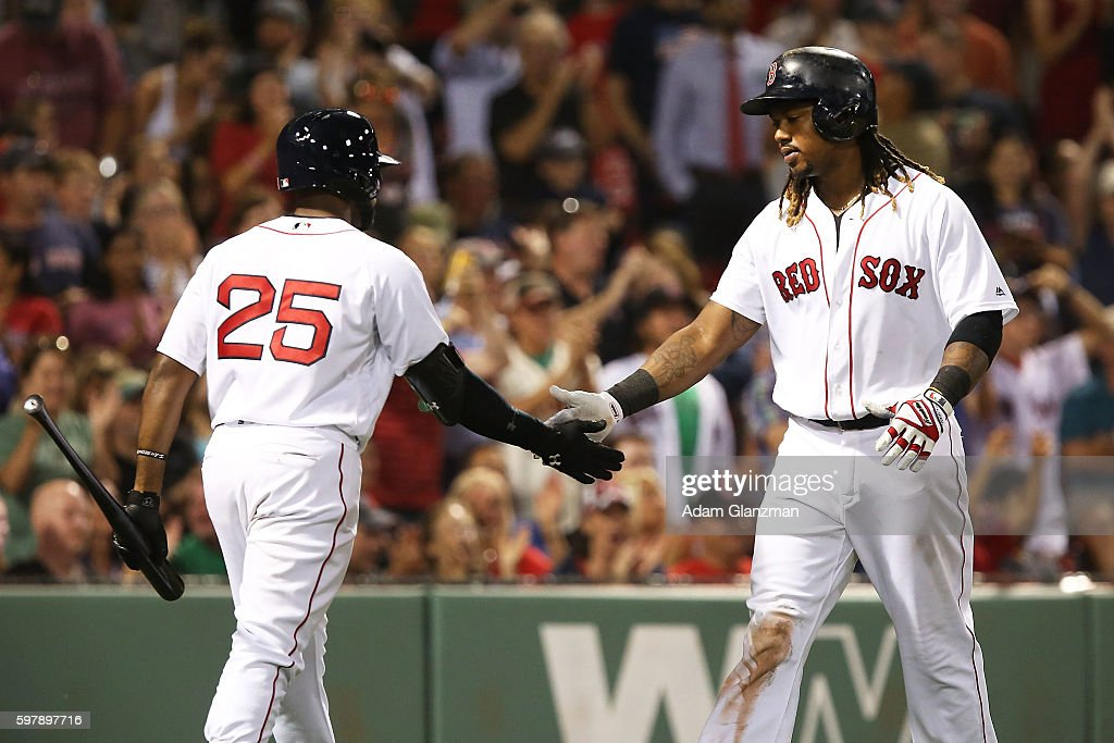 Hanley Ramirez high fives Jackie Bradley Jr #25 of the Boston Red Sox after scoring in the seventh inning during a game against the Tampa Bay Rays at...