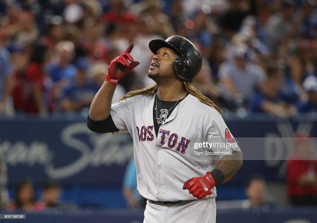 Hanley Ramirez #13 of the Boston Red Sox celebrates after hitting a two-run home run in the seventh inning during MLB game action against the Toronto Blue Jays at Rogers Centre on July 2, 2017 in Toronto, Canada.