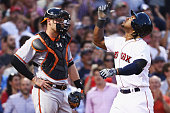 Hanley Ramirez of the Boston Red Sox celebrates in front of Matt Wieters of the Baltimore Orioles after hitting a three run homer during the third...