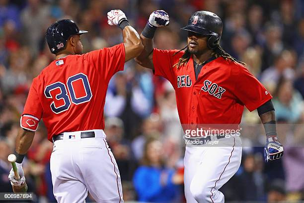 Hanley Ramirez of the Boston Red Sox celebrates with Chris Young after hitting a home run against the New York Yankees during the fourth inning at...
