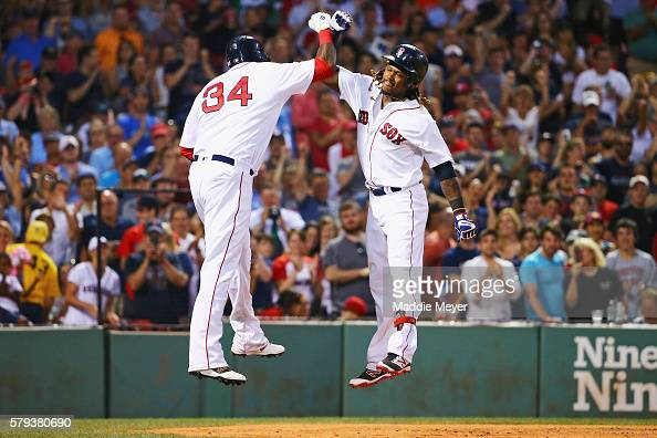 Hanley Ramirez of the Boston Red Sox celebrates with David Ortiz after hitting a threerun home run during the second inning against the Minnesota...