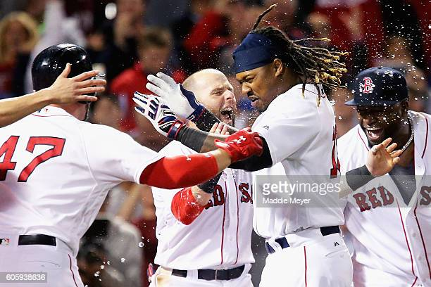 Hanley Ramirez of the Boston Red Sox celebrates with David Ortiz and Dustin Pedroia after hitting the game winning three run homer against the New...