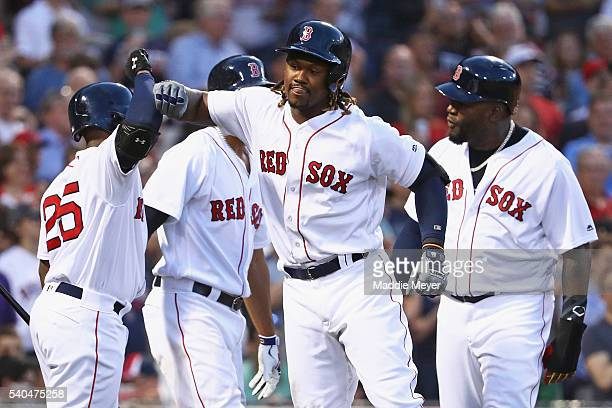 Hanley Ramirez of the Boston Red Sox celebrates with Jackie Bradley Jr #25 David Ortiz and Xander Bogaerts after hitting a three run homer during the...