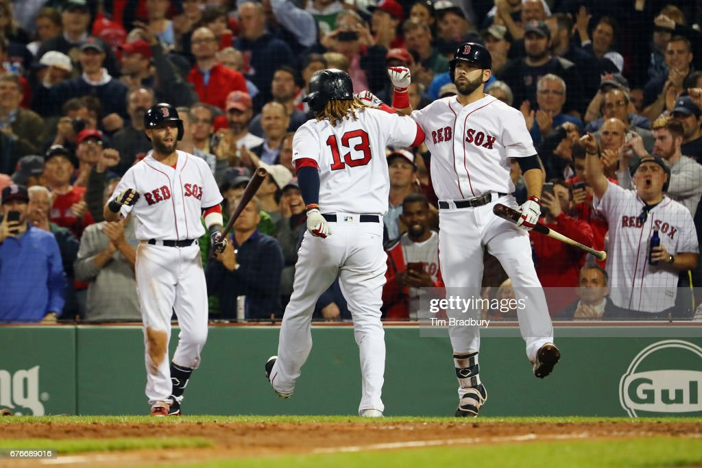 Hanley Ramirez #13 of the Boston Red Sox celebrates with Mitch Moreland #18 after hitting a solo home run during the sixth inning against the Baltimore Orioles at Fenway Park on May 2, 2017 in Boston, Massachusetts.
