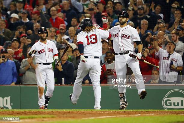 Hanley Ramirez of the Boston Red Sox celebrates with Mitch Moreland after hitting a solo home run during the sixth inning against the Baltimore...