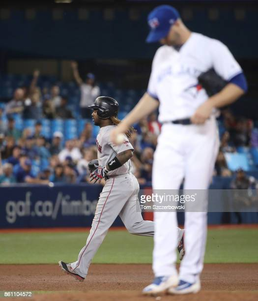Hanley Ramirez of the Boston Red Sox circles the bases after hitting a solo home run in the fifth inning during MLB game action as JA Happ of the...