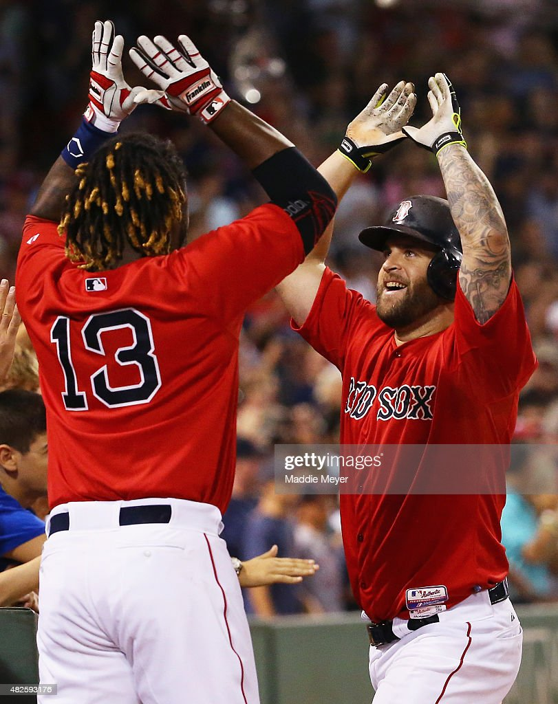 Hanley Ramirez of the Boston Red Sox congratulates Mike Napoli after he hit a two run homer during the seventh inning against the Tampa Bay Rays at...