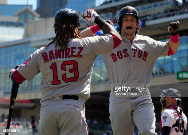 Hanley Ramirez of the Boston Red Sox congratulates teammate Andrew Benintendi on a tworun home run against the Minnesota Twins during the first...