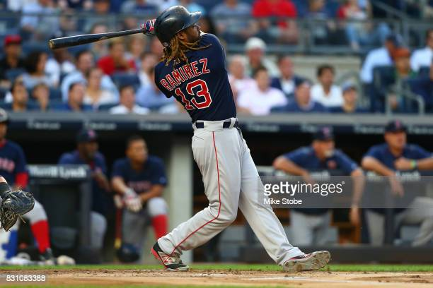 Hanley Ramirez of the Boston Red Sox connects on a 2run home run in the first inning against the New York Yankees at Yankee Stadium on August 11 2017...