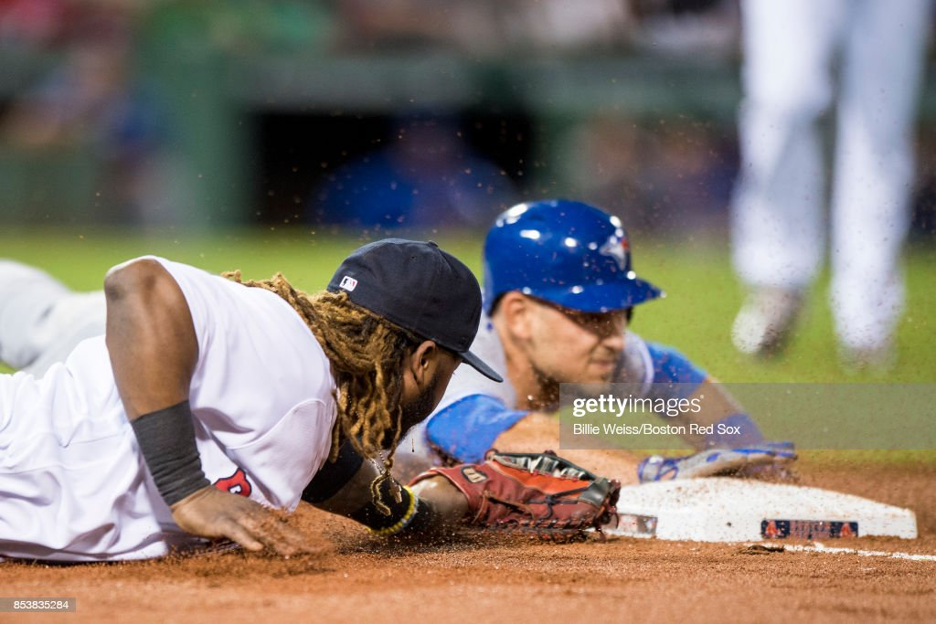 Hanley Ramirez #13 of the Boston Red Sox dives as he attempts to tag Luke Maile #22 of the Toronto Blue Jays during the second inning of a game on September 25, 2017 at Fenway Park in Boston, Massachusetts.