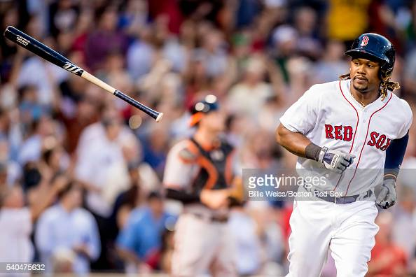 Hanley Ramirez of the Boston Red Sox flips his bat after hitting a three run home run during the third inning of a game against the Baltimore Orioles...