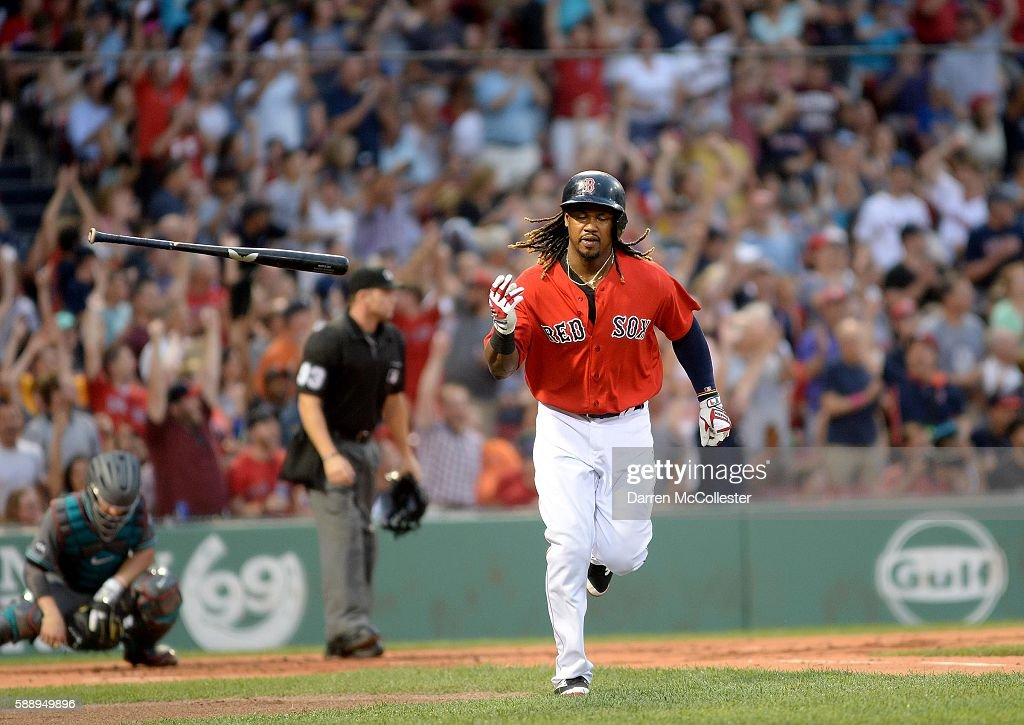 Hanley Ramirez of the Boston Red Sox flips his bat after hitting a homerun in the first inning against the Arizona Diamondbacks at Fenway Park on...
