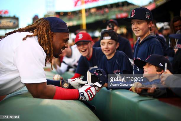 Hanley Ramirez of the Boston Red Sox gives his hat to a young fan before a game against the New York Yankees at Fenway Park on April 27 2017 in...